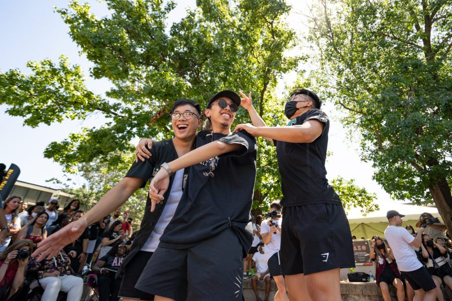 Members of Chi Sigma Tau fraternity gets hyped during yard show on Aug 24.