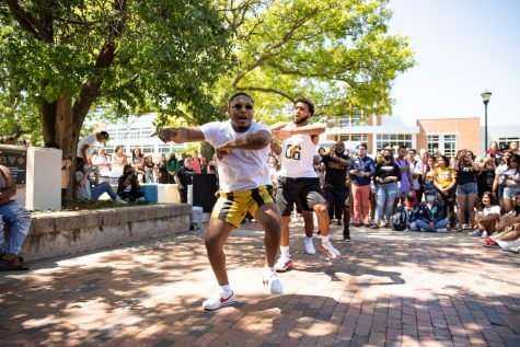 Members of Alpha Phi Alpha fraternity stroll during yard show on Aug 24.