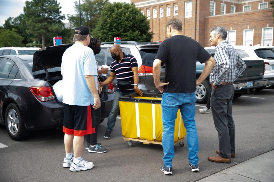 President Rick Muma and his husband help students move into Shocker Hall and The Flats at WSU on August 13