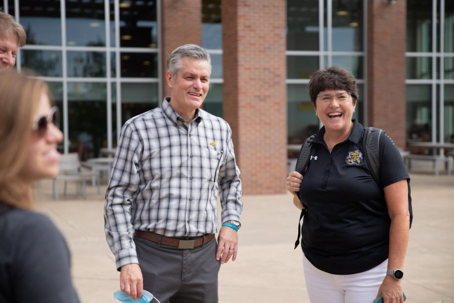President Rick Muma catches up with staff members and they are happy to see so many people on campus during move in day on August 13