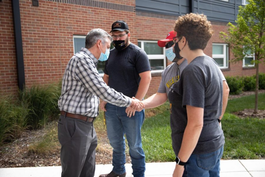 President Rick Muma meets a students parents as they are moving their son into his new place, The Flats at WSU on August 13
