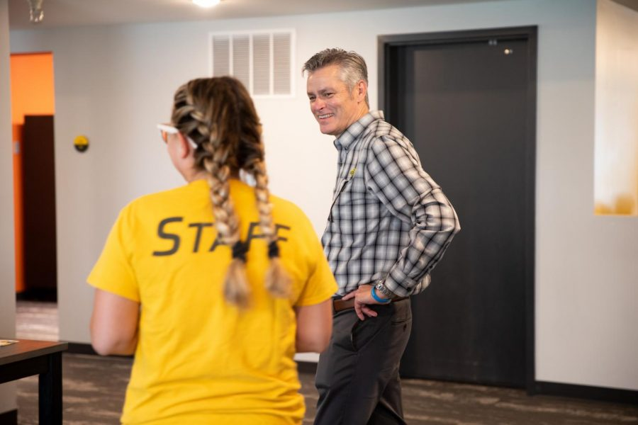 President Rick Muma laughs while being given a tour of The Flats at WSU by a staff member on August 13