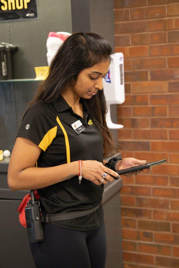 Wichita State student Pavita Paramesuvaran works at the Haskett Center.