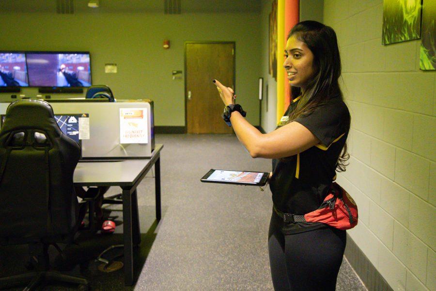 Wichita State student Pavita Paramesuvaran works at the Haskett Center. She is showing the E-sports center.