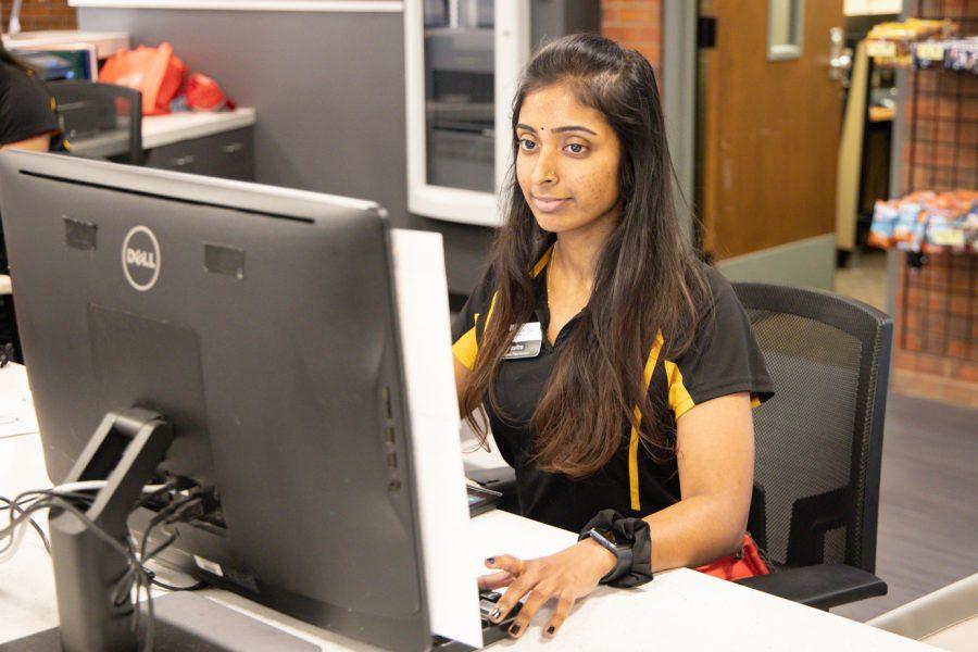 Wichita State student Pavita Paramesuvaran works at the Heskett Center.