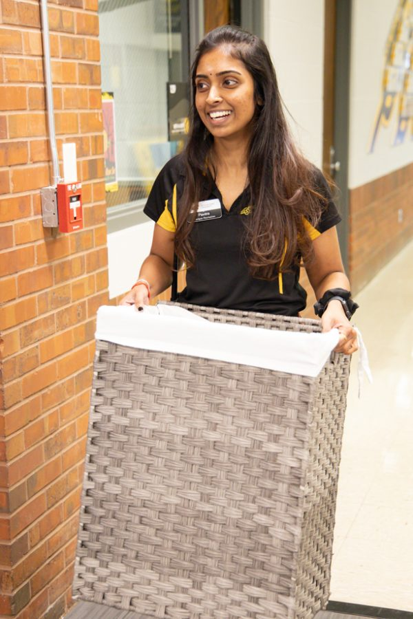 Wichita State student Pavita Paramesuvaran works at the Haskett Center. She is taking the towels to washed.