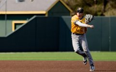 Junior Andrew Stewart throws the ball towards first base during WSU's game against on Sept. 13 at Eck Stadium.