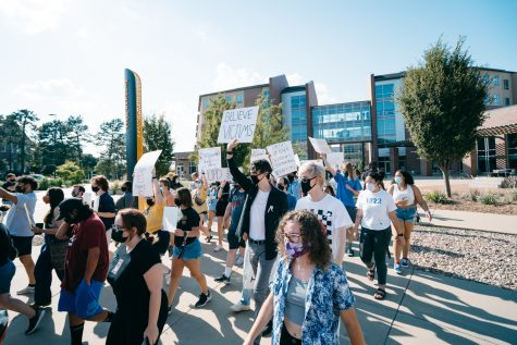 Students marching from Shocker Hall to the University Police department as a part of their protest Friday. The protest was calling for immediate action from the university police department after alleged sexual assault on campus.