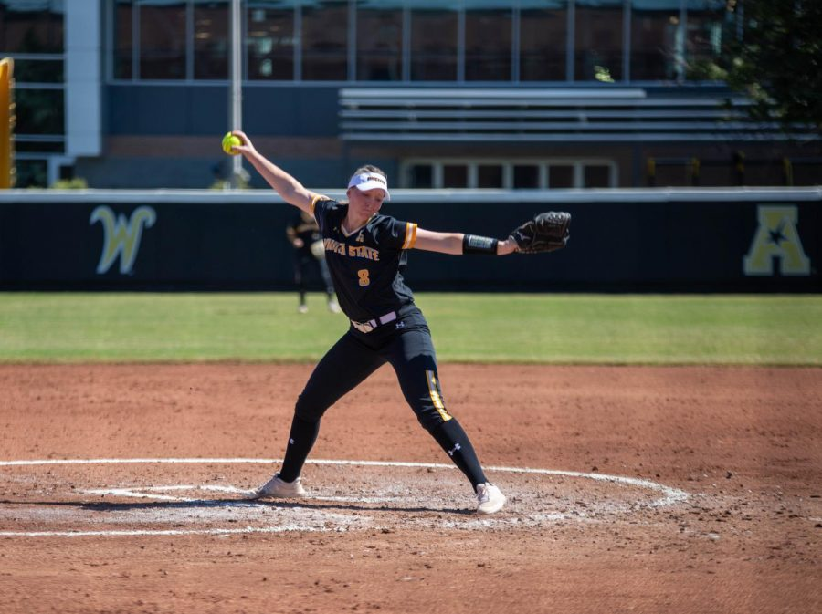 Wichita State senior Caitlin Bingham throws a pitch during a game against Kansas on Sept. 25 inside Wilkins Stadium.