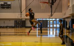Wichita State junior Ricky Council IV goes up for a dunk during their first day of official practice on Sept. 28 inside the Charles Koch Arena Practice Gym.