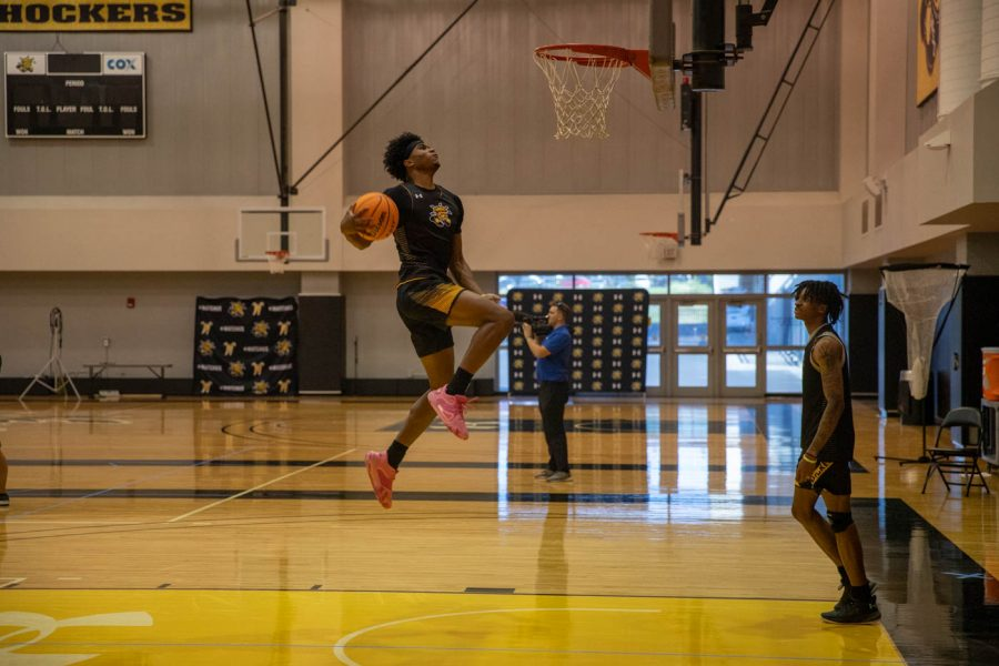 Wichita+State+junior+Ricky+Council+IV+goes+up+for+a+dunk+during+their+first+day+of+official+practice+on+Sept.+28+inside+the+Charles+Koch+Arena+Practice+Gym.