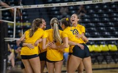 The Wichita State volleyball team celebrates after scoring a point during their match against Creighton on Sept. 18 inside Charles Koch Arena.