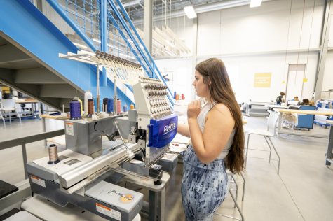 Nursing sophomore Lindsay Dexter works with an embroidery machine in GoCreate on Sept. 15