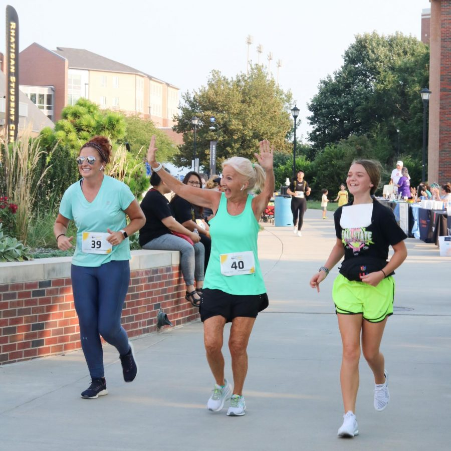 Lots of smiling runners participating in the Suspenders4Hope  run/walk event at the Wichita State Student Rhatigan Student Center on Sept 11.