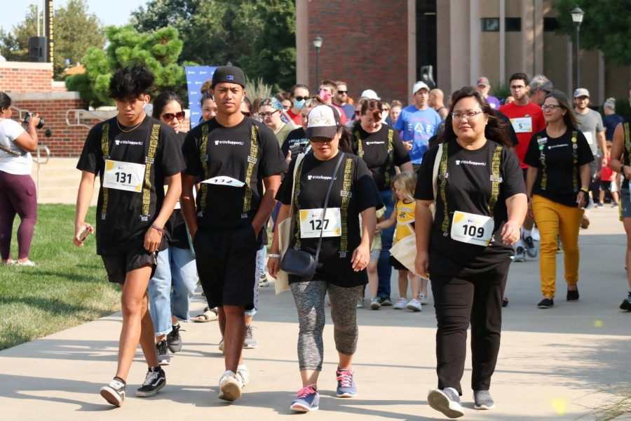 A group walks together during a Suspenders4Hope  run/walk event at the Wichita State Student Rhatigan Student Center on Sept 11.