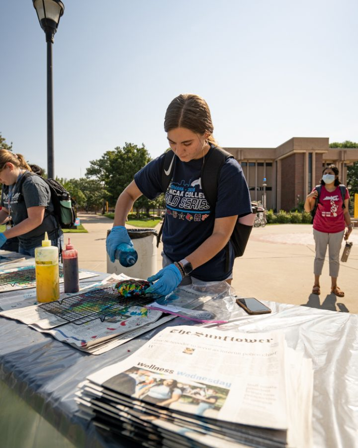Graphic design sophomore Morgan Zimmerman dyes a shirt at SACs Tie-Dye Tuesday. The event was held on Sept 7 in front of the RSC.
