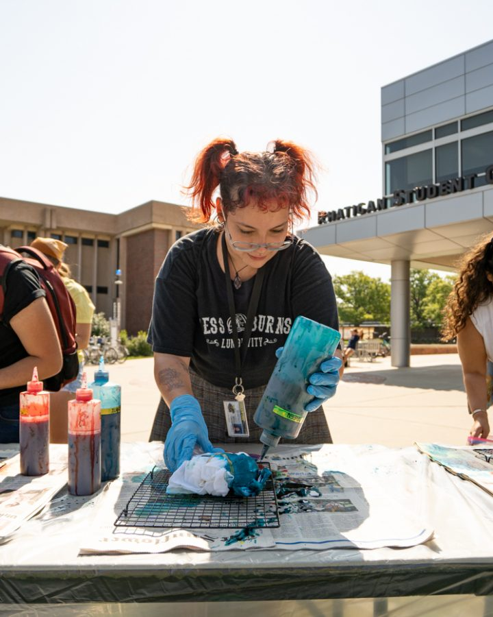 Exchange student Nadia Pfannl dyes her shirt at Tie-Dye Tuesday. The event was held on Sept 7 in front of the RSC.