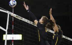Shockers rally to defeat South Dakota in five sets