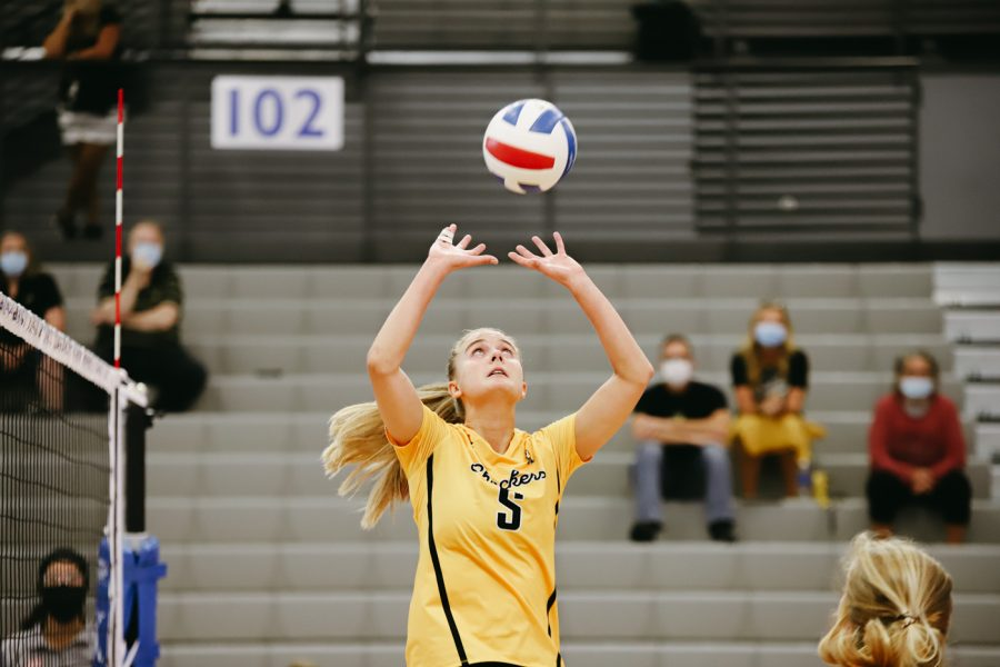Junior Kayce Litzau sets the ball during the game against Delaware on Sep 11 at Horejsi Family Volleyball Center.