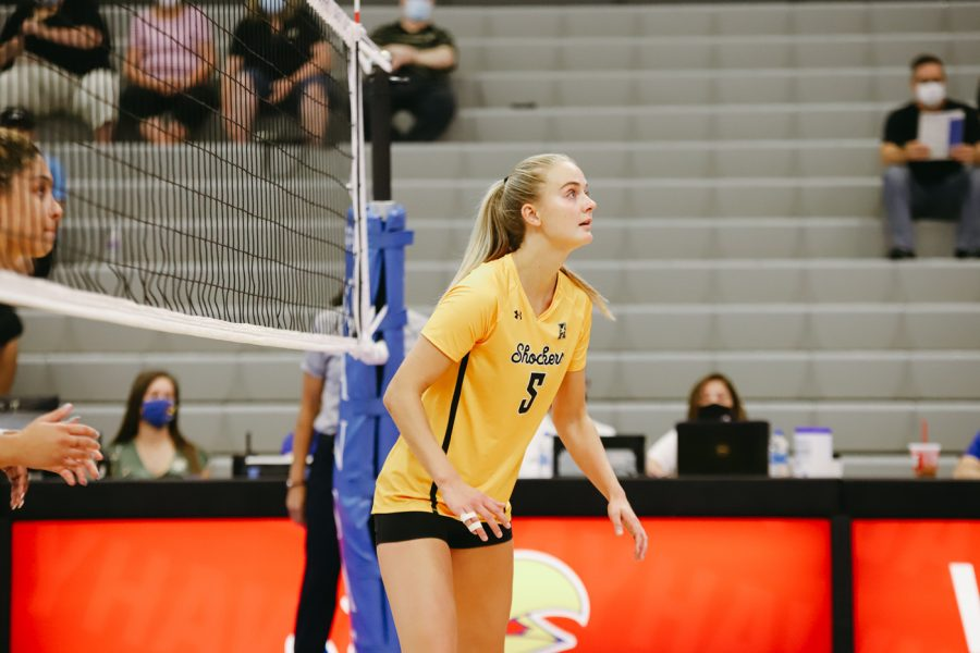 Junior Kayce Litzau waits for a serve during the game against Delaware on Sep 11 at Horejsi Family Volleyball Center.