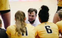 Head coach Chris Lamb talks to the team during the game against Delaware on Sep 11 at Horejsi Family Volleyball Center.