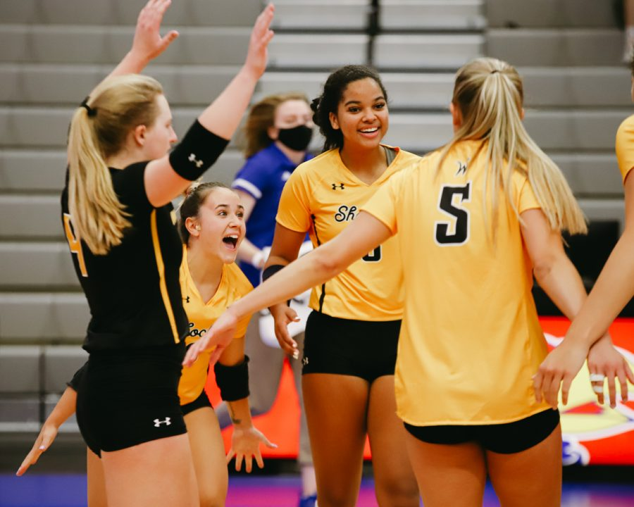 Wichita State players celebrates during the game against Delaware on Sep 11 at Horejsi Family Volleyball Center.