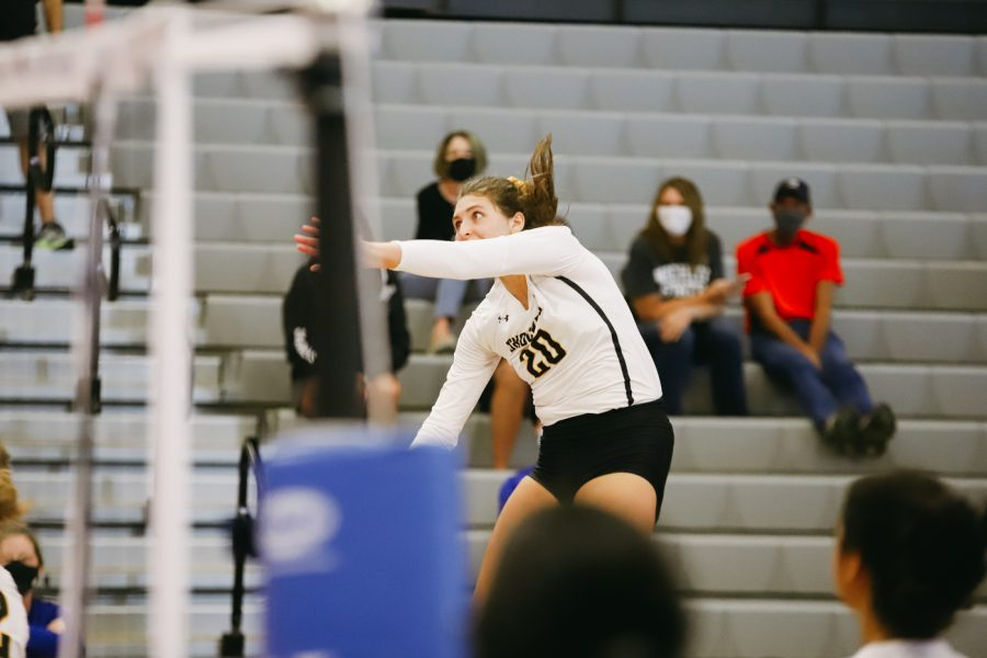 Junior Sophia Rohling spikes the ball during the game against Kent State University on Sep 10 at Horejsi Family Volleyball Center.