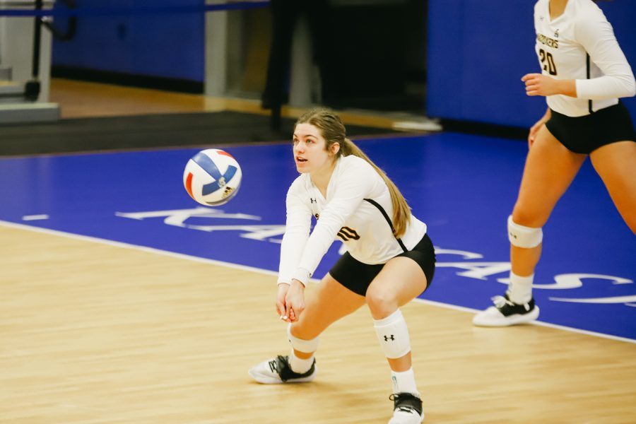 Freshman Annalie Heliste digs the ball during the game against Kent State University on Sep 10 at Horejsi Family Volleyball Center.