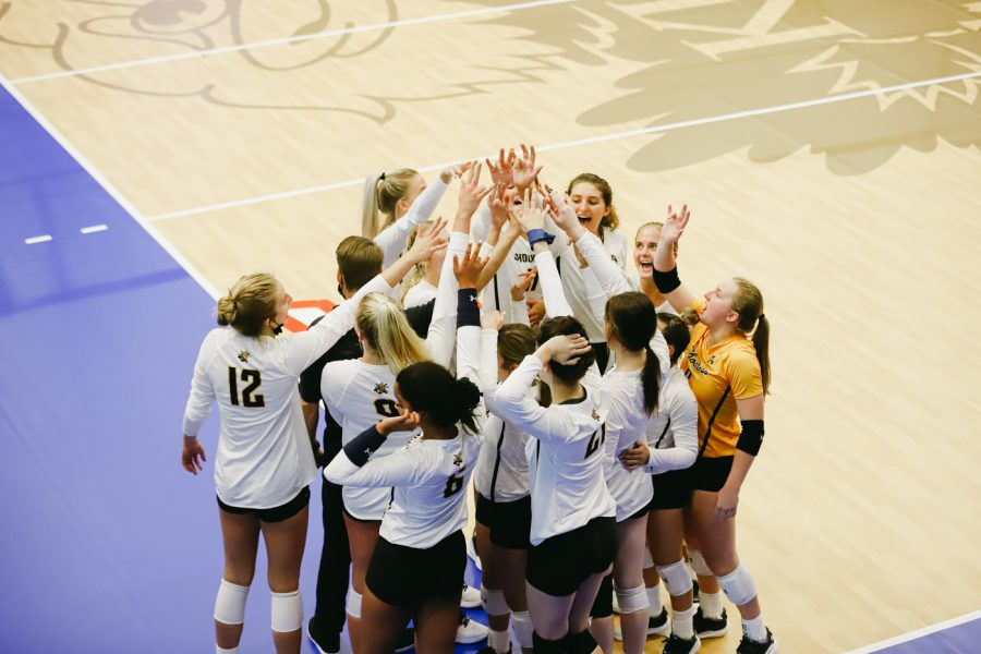 Wichita State players celebrate after the win against Kent State University on Sep 10 at Horejsi Family Volleyball Center.