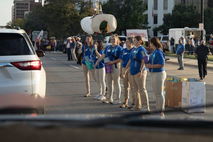 Greeters wearing the #WeSupportYou suspenders for hope shirts at the Riverfest reverse parade on Oct. 1, 2021.