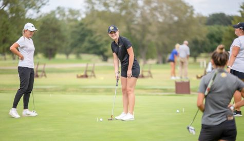 Senior Louisa Brunt prepares to hit a put during a practice on Oct. 6 at Crestview Country Club.