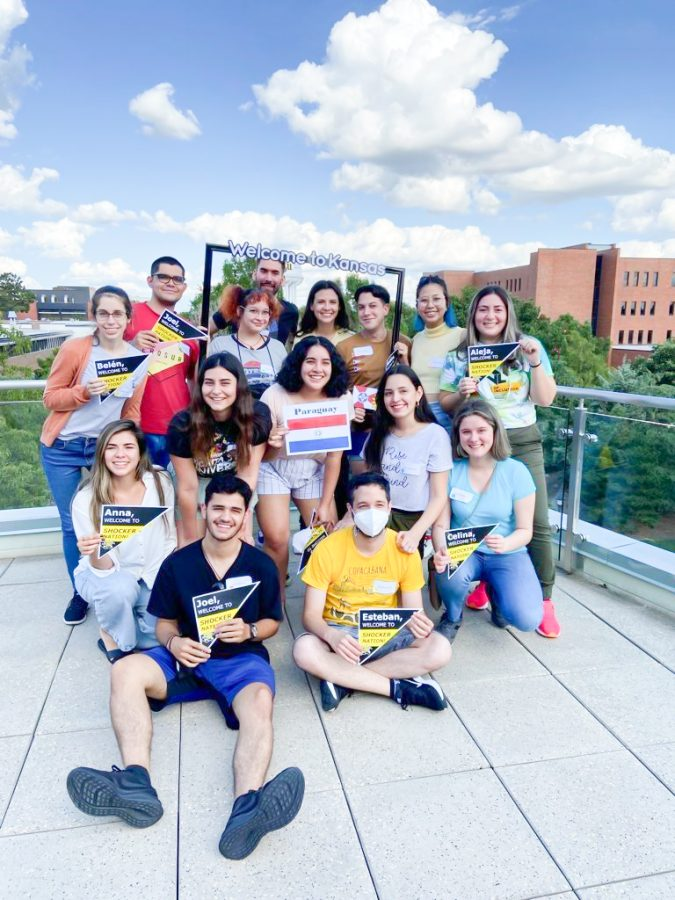 Students from Paraguay pose on the Rhatigan Student Center balcony.
