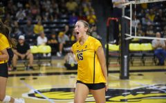 Wichita State freshman Morgan Stout celebrates after a point during their match against UCF on Oct. 1 inside Charles Koch Arena.