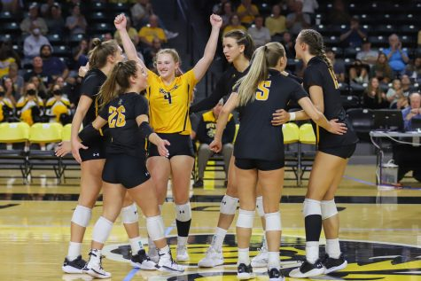 The Shockers celebrate after scoring a point against Southern Florida on Oct. 3 at the Charles Koch Arena.