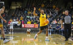 Sophomore Tyson Etienne drives towards the basket during Shocker Madness on Oct. 12 inside Charles Koch Arena.