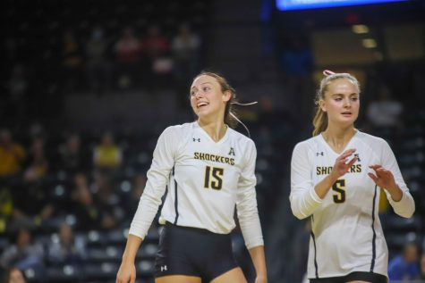 Freshman Morgan Stout celebrates after a point during their game against East Carolina on Oct. 15 inside Charles Koch Arena.