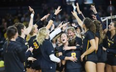 The Shocker volleyball team celebrates their come-from-behind win against Cincinnati on Oct. 17 inside Charles Koch Arena.