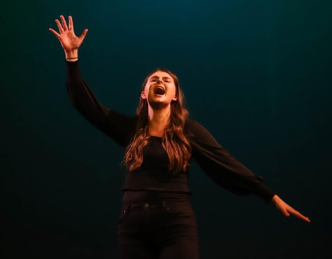 Performing Defying Gravity from Wicked, senior Megan Ahern sings and plays the role of The Wicked Witch of the West, Elphaba.