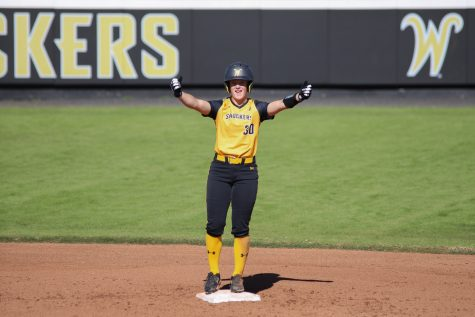 Sophomore Addison Barnard celebrates after hitting a double against Fort Hays on Oct. 17 in Wilkins Stadium.