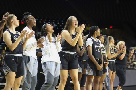 The womens basketball team cheers on Asia Strong during the finals of Shocker Madness on Oct. 12 in Charles Koch Arena.