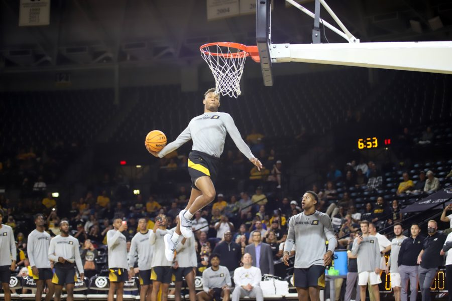 Junior+Dexter+Dennis+goes+up+for+a+dunk+during+the+Shocker+Madness+dunk+contest+on+Oct.+12+inside+Charles+Koch+Arena.