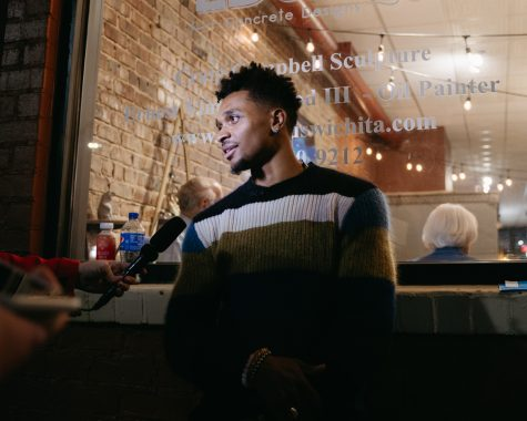 Sophomore Tyson Etienne talks to the media during his photography exhibition on Oct 23 in downtown Wichita.